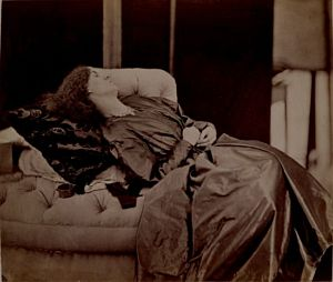 Jane Morris reclining on divan