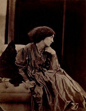 Jane Morris seated on divan, three quarter length