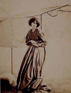 Jane Morris standing, in marquee